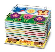 This sturdy wire rack is ideal for organizing and storing wooden puzzles. Comes preassembled and easily holds up to 12 standard 9 x 12 puzzles. (Case fits standard puzzles and peg puzzles; does not fit Chunky Puzzles, Jumbo Knob Puzzles, Sound Puzzles, Latches Board, and other large activity boards.)