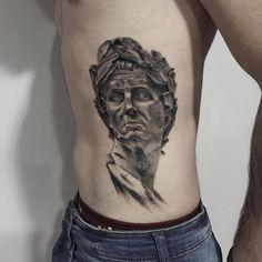 Nicolas Coustou's Julius Caesar's sculpture tattoo on the left side.