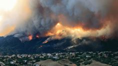 A stubborn and towering wildfire jumped firefighters' perimeter lines in the hills overlooking Colorado Springs, forcing frantic mandatory evacuation notices for more than 9,000 residents, destroying an unknown number of homes and partially closing the grounds of the sprawling U.S. Air Force Academy.