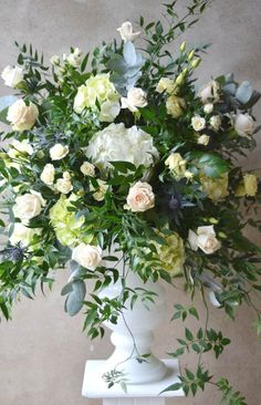 Here is an urn arrangement I made for a recent wedding at Caswell House near Witney.I love the soft peach tones of the Talea rose against white hydrangea, cream Vendela rose and antique blue thistles. Trailing jasmine softens the look and adds a send of movement.
