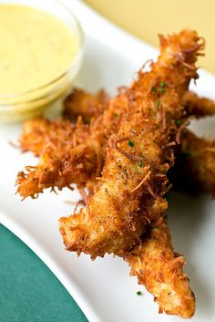 Coconut Crunch Chicken Strips with Creamy Honey-Mango Dipping Sauce from The Cozy Apron