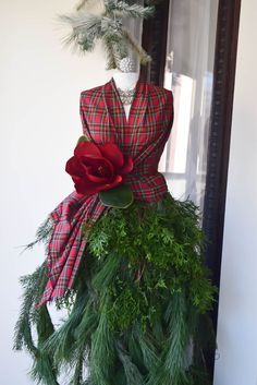 What a clever and unusal way of adding Christmas decorations to the house for the holidays. I LOVE this mannequin dressed in tartan and greens. Tartan Christmas, Christmas Swags, Magical Christmas, Vintage Christmas, Christmas Holidays, Christmas Crafts, Christmas Ideas, Christmas Stuff, Beautiful Christmas