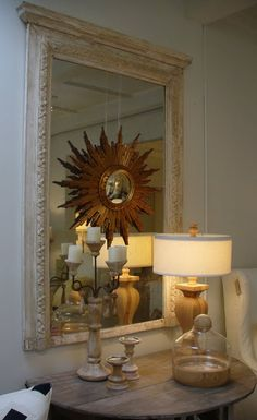One of my favorite decorating tricks.....mirror mounted on mirror....really pretty here with the sun burst mirror