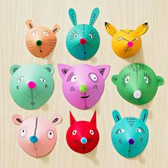 DIY: Decorate a wall to look like a zoo with colorful and cute animal faces!