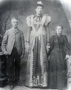 "A young Ella Ewing, ""The Missouri Giantess"" with her parents. C. 1890."