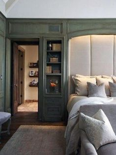 Glamorous bookcase headboard in Bedroom Birmingham with Lighting Above Bed next to Closet Behind Bed alongside Tudor Home and Basement Bedroom Headboard From Old Door, Bookcase Headboard, Wall Headboard, Bookshelf Wall, Closet Behind Bed, Bed Nook, Cozy Nook, Headboard Designs, Headboard Ideas