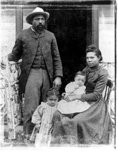 African American settlers in Oklahoma. Believe me,they are very prosperous for those days (white or black).She has a beautiful dress, he has a suit and the children are very well dressed.If you check out other pioneer pictures you will see by comparison, how well to do they are. And they had the money to pay a traveling photographer. Biddy Craft