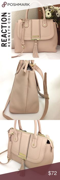 """SALE❗️🎉HP🎉Kenneth Cole Reaction Satchel Brand New with tags! This gorgeous Norway satchel by Kenneth Cole Reaction in pale blush is such a great spring addition to your collection. Made of rich pebbled faux leather, this bag features dual rolled handles, oversized tassel and gold tone metal lettering logo at front; fully lined interior; interior zip and slip pockets; one front magnetic snap flap pocket; comes with adjustable/detachable Crossbody strap. Measures 13.5""""W X 11""""H X 6""""D Handle…"""