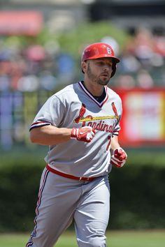 CHICAGO, IL - JULY 27: Matt Holliday #7 of the St. Louis Cardinals rounds the bases after hitting a solo home run during the first inning ag...