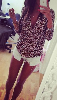 Cheetah print half-sleeve and white shorts! They need to be a little longer but cute