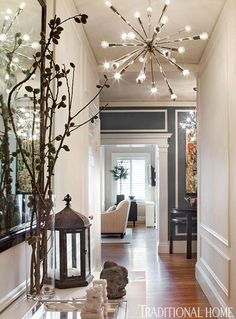 Neutral paint that embraces the light-colored furniture and shows off the occasional colorful accessory. The exception was the hallway that stitches all the rooms together. There she splashed the walls with a rich slate blue to lend dimension and contrast to the other mostly quiet spaces.