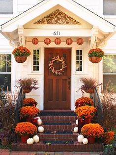 front porch...  Loving the white pumpkins and orange mums on stairs