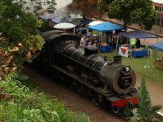 """The Inchanga Choo Choo pulled by the class locomotive """"Maureen"""" arriving at Inchanga Railway Station. Taken by Bruce D Bennett Steam Railway, Rolling Stock, Locomotive, Military Vehicles, Shed, Lean To Shed, Vehicles, Army Vehicles, Coops"""