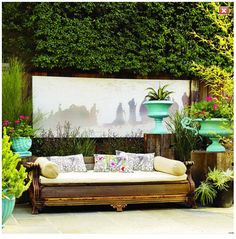 This landscape artist repurposed an antique couch into an outdoor daybed. She took away all of the reupholstery and then utilized recycled wood to create a new bench seat.