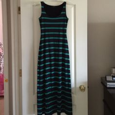 Maxi Dress Navy Blue and Green Maxi Dress in great condition not see thru at all - am reposhing it didnt fit me too small Soprano Dresses Maxi