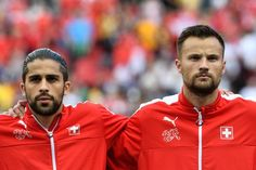 Switzerland's defender Ricardo Rodriguez (L) and Switzerland's forward Haris Seferovic line up ahead of the start of the Euro 2016 group A football match between Romania and Switzerland at the Parc des Princes stadium in Paris on June 15, 2016. / AFP / MIGUEL MEDINA