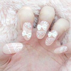 White Lace and bow nail design