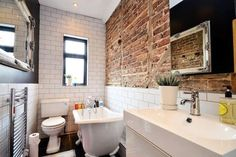 Exposed brick bathroom. Kinda love this!