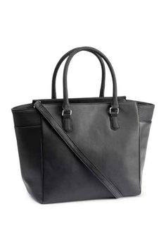 615789a5904 Handbag in imitation leather with two handles, zip at top, and detachable  shoulder strap. Three inner compartments, one with zip. Size 5 x