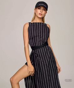 Getting sporty, Hailey Baldwin wears Balenciaga baseball cap and striped dress for Harper's Bazaar Magazine Spain January 2017 issue