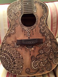 Wood burn guitar by Aimee