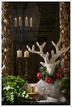 """""""This unparalleled antique French deer is the centerpiece of this grouping which also features a pair of century Italian columns. Candle: """"Noel"""" by Annick Goutal, Paris. Noel Christmas, Winter Christmas, All Things Christmas, Christmas Crafts, Christmas Decorations, Xmas, Christmas Ornaments, Christmas Vignette, Frugal Christmas"""
