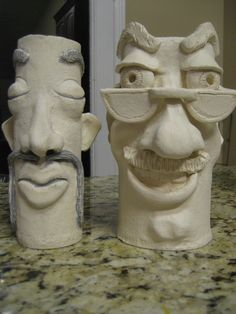 Cylinder faces... one formed on a paper towel roll, the other on a Pringles can.