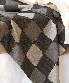 If quilting is your thing and you have the time, you could create a cosy, warm quilt using old suits. Line it with old curtain fabric - velvet, silk, or damask. For a jaunty look, tie bits of yarn at each corner square.