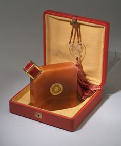 Art Deco Divinez Crystal Perfume Bottle in Deluxe Display Box with Tassled, Heart-Shaped Glass Ornament by René-Jules Lalique (c.1927) by Baccarat for Ybry, France