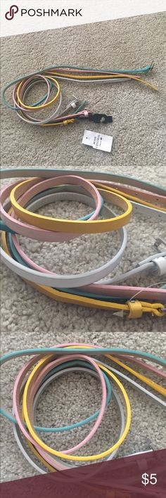 Skinny waist belts FOUR skinny waist belts. Can be worn with jeans or your fav dress/Tshirt. All sizes small or xs . Yellow, Aqua, Lit. pink, and Sparkly White. Accessories Belts