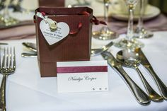 Very beautiful yet simple looking name tags with favour gift bags. Burgundy colour schemed Wedding.