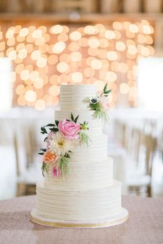 Ribboned wedding cake with flower detail, blush and ivory #wedding #décor #love