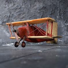 We are proud to offer an early Century folk art wooden hand painted red bi-plane from a windjammer. Antiques Online, Selling Antiques, Antique Market, Wooden Hand, Wood And Metal, House Styles, Plane, Games, Toys