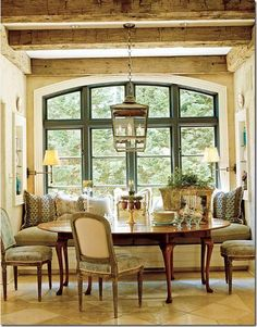 Built in banquette seating. French country. Beams. Window.