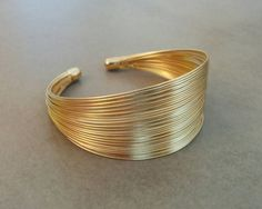 Gold Cuff Bracelet, Gold Bracelet, Cuff Bracelet, Gold Bangle, Wedding Jewellery, Simple Gold Cuff, Gift For Her, Bridesmaid Gift Golden Strips Cuff Bracelet, Made of 24k gold plated brass base, matte finished. Dimensions: Diameter: 2.7 inch / 7 cm Width: 1.1 inch / 3 cm