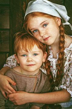 Two red haired children by Karina Kiel