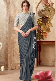 Look gorgeous in this Dark Grey Color Lycra Lehenga Style Party Wear Saree Blouse. This engaging attire is displaying some amazing fancy embellishment work Sari Design, Sari Blouse Designs, Saree Jacket Designs, Choli Designs, Saree Draping Styles, Saree Styles, Drape Sarees, Blouse Styles, Trendy Sarees
