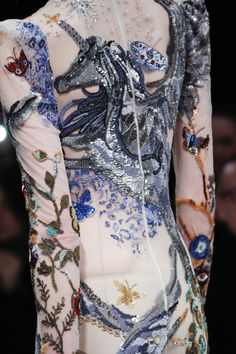 McQueen embroidery and sequin embellishment.