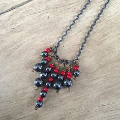 Hematite & Red Seed Beads Wire Wrapped Necklace made by A Sapphire Spirit, a jewelry shop on Etsy.