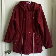 Cute burgundy jacket for winter Has two pockets and a removable hood. It has floral embroidery. Perfect for winter. Lightly worn. Can probably fit XL as well. Jackets & Coats Puffers