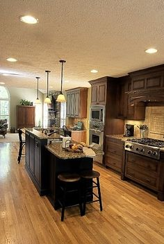 Like the cabinet and countertop color combo. Also like the cooktop with wood drawers underneath.