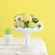 Easter Eggs with flowers in vintage pedestal