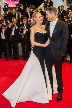 Blake Lively wore a Gucci Première black and white silk crepe strapless gown as she joined her husband Ryan Reynolds - wearing a Gucci tuxedo - on the red carpet.