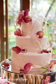 Wedding cake with flowers styled by the Flower Gallery of Asheville.