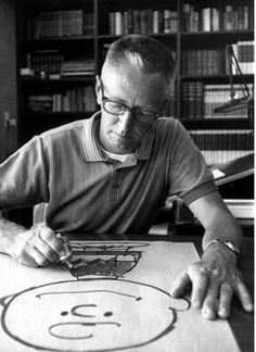 Charles Schulz draws Charlie Brown at his Sebastopol, California home in 1966 • photo: Associated Press on Times Topics