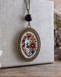 Ochre and black flowers embroidered necklace, Floral necklace, Cross stitch necklace, Flowers hand embroidery pendant, Textile jewelry