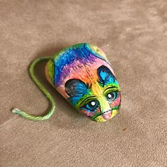 Hand Painted Lisa Frank Inspired Rainbow Mouse Stone - omg guys, do I love this little rainbow mouse! Adorable psychedelic rainbow mouse painted on a smooth Caribbean Beach pepple. Who didnt love all of Lisa Franks awesome colors and animals! I think this little guy really captures the essence of her style! Complete with an adorable yarn tail for added realism!  One of a kind unique animal stone painting, perfect gift for the animal or mouse lover! Excellent for display, as an adorable…