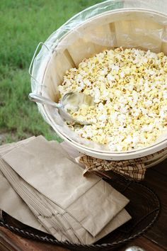 Popcorn bar from End of the Trail Waupun WI! Popcorn Bar with assorted toppings and add-ins. Could do this with fun toppings (candy corn, M etc) instead of decorate your own cookie. Outdoor Movie Party, Backyard Movie, Backyard Parties, Backyard Bonfire Party, Rooftop Party, Backyard Bar, Outdoor Parties, Popcorn Bar, Popcorn Stand
