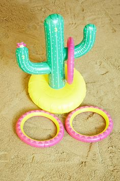 An inflatable ring toss game by Sunny Life™ featuring a cactus design with throwing rings that can be played while worn, in the pool, or on the ground.