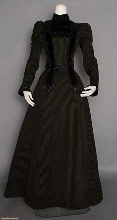 """PIN STRIPED DINNER ENSEMBLE, 1890 C/o bodice, skirt & capelet, black cotton w/ raised lime green pinstripes, bodice w/ black velvet & jet beaded trim & fringes, B 30"""", W 24"""", Skirt L 39"""" Suddon-Cleaver Costume Collection"""